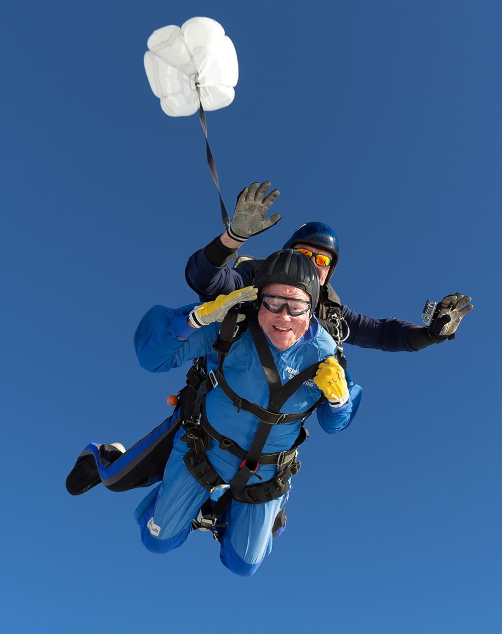 Vernon Maynard, bottom, skydives with instuctor James Perez to celebrate his 100th birthday over Perris, Calif.