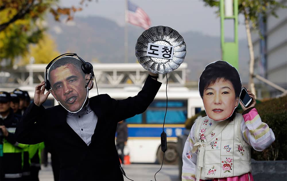 South Korean protesters wearing masks of US President Barack Obama, left, and South Korean President Park Geun-hye perform during a rally denouncing US National Security Agency`s alleged spying on its allies near the US Embassy in Seoul, South Korea.