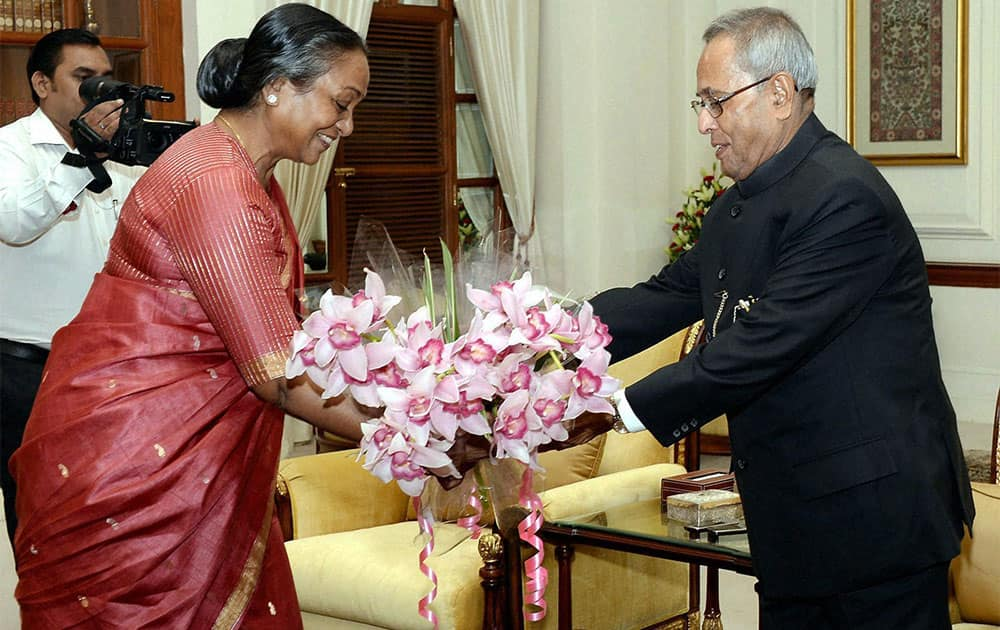Lok Sabha Speaker Meira Kumar greeting President Pranab Mukherjee on Diwali at Rashtrapati Bhavan in New Delhi.