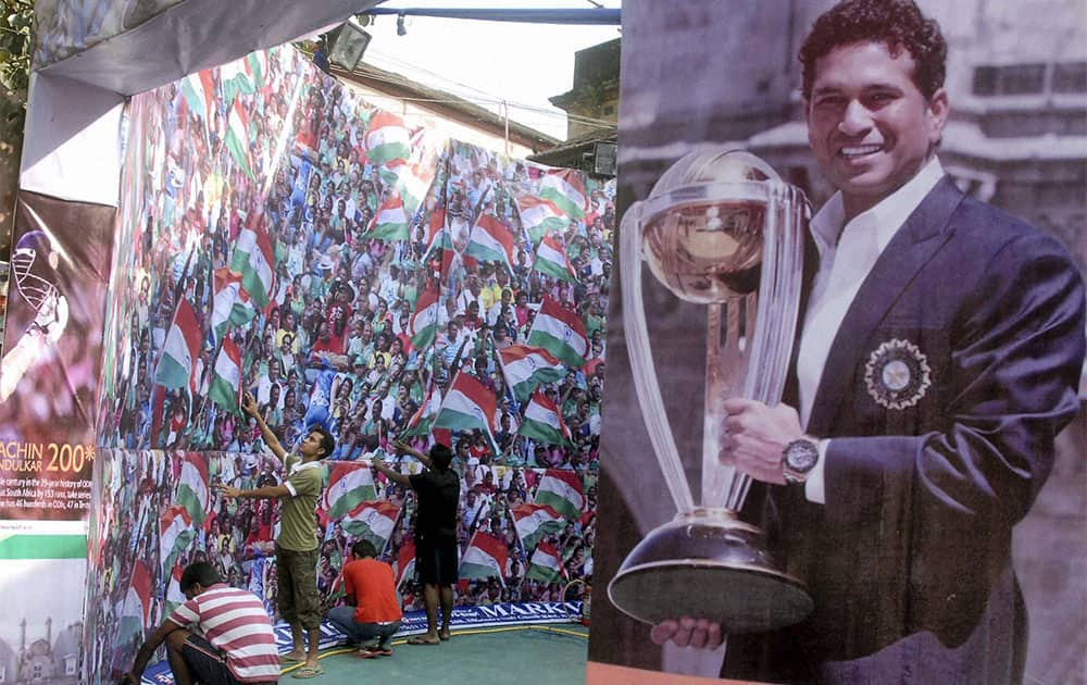 Cricket fans make a goddess Kali puja pandal for the success of the Indian cricket team and the milestone of master blaster Sachin Tendulkar during Kali puja and Diwali festivals ahead of upcoming test matches of India and Sachins`s 199th Test match at Eden Gardens,in Kolkata.