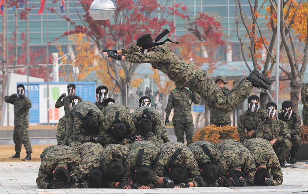 A member of the South Korean Army Special Forces demonstrates his martial arts skills during the Seoul International Aerospace and Defense Exhibition 2013 in Goyang, South Korea.