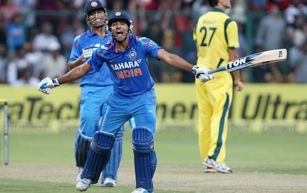 Rohit Sharma celebrates his double century during the 7th ODI cricket match against Australia at Chinnaswamy stadium in Bengaluru.