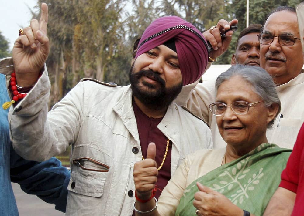 Delhi Chief Minister Sheila Dikshit and Punjabi pop singer Daler Mehndi at the launch of an election campaign DVD at her residence in New Delhi.