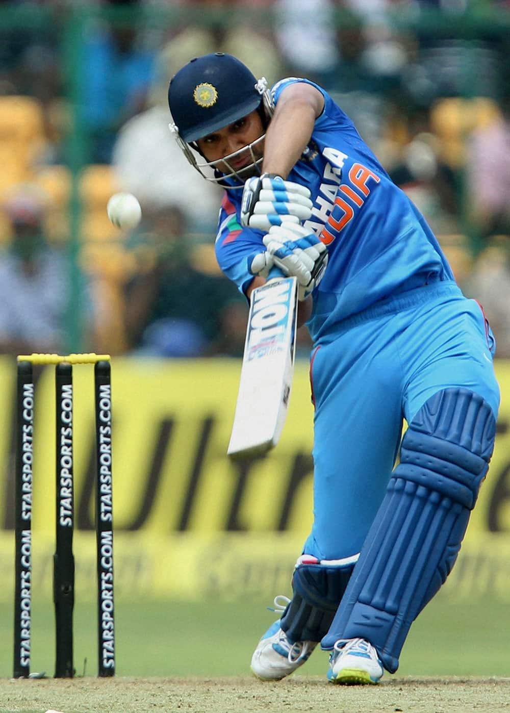 Rohit Sharma plays a shot during the 7th ODI against Australia at Chinnaswamy stadium in Bengaluru..