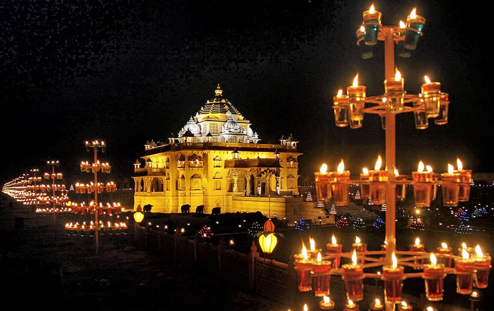The Akshardham temple is illuminated with lamps and light during Diwali festival in Gandhinagar.