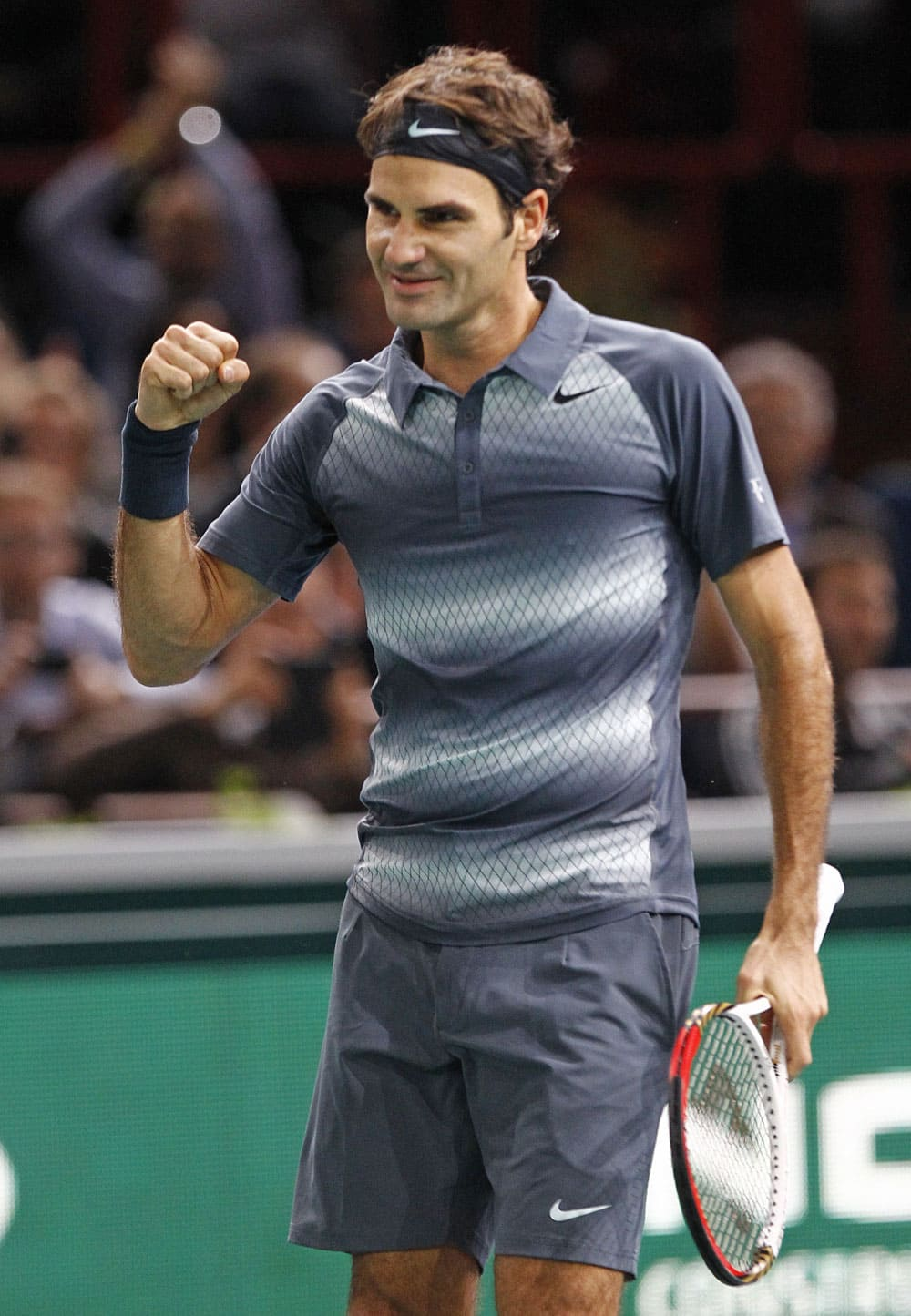 Switzerland`s Roger Federer reacts after winning his match against Argentina`s Juan Martin Del Potro at the Paris Masters tennis, in the Paris Bercy stadium.