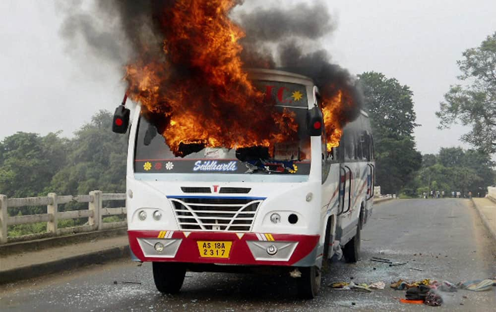Protesters set ablaze a bus during a bandh called by non-Rabha organizations against proposed Rabha Hasong Autonomous Council elections in Krishnai, Assam.