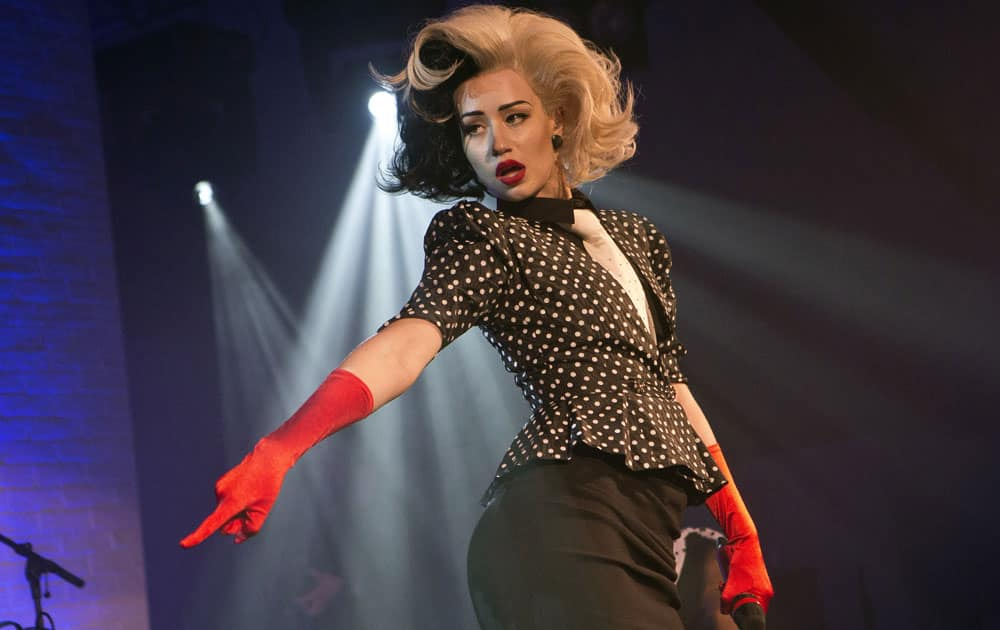 Australian singer Iggy Azalea performs on stage dressed as Cruella De Vil, for the Vevo Halloween Concert at the Oval Space in London.