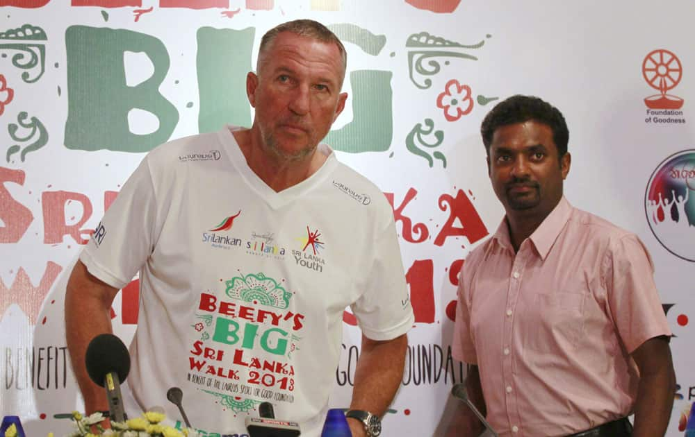 Former England`s cricketer Ian Botham, left and Sri Lankan spin bowler Muttiah Muralitharan arrive for a press conference to announce an event, called Beefy's Big Walk in Colombo, Sri Lanka.