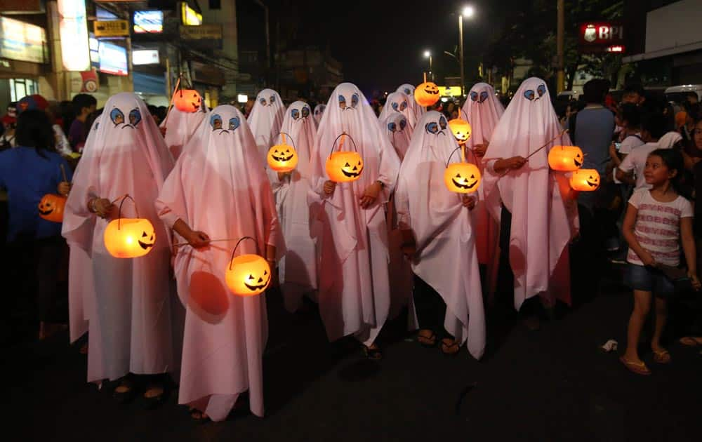 Filipinos wear ghost costumes as they join a Halloween Parade in Marikina city, east of Manila.