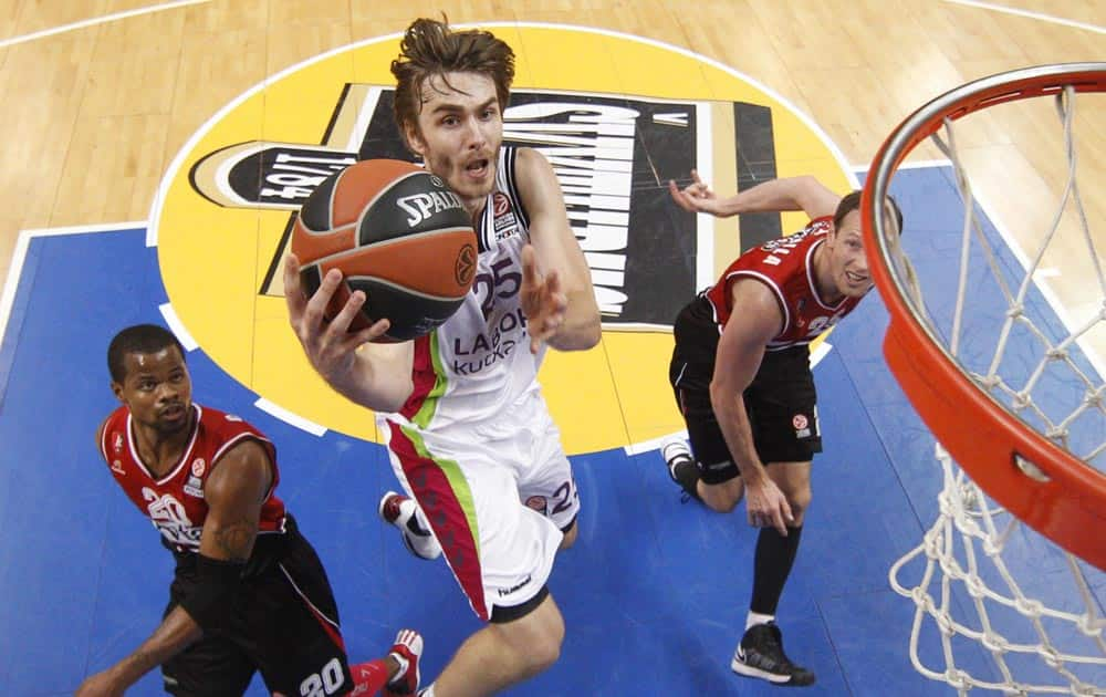 David Jalinek, center, of Spain`s BC Laboral Kutxa Vitoria, makes an attempt at the basket, during a Euroleague basketball match against Lithuania`s BC Lietuvos Rytas in Vilnius, Lithuania.