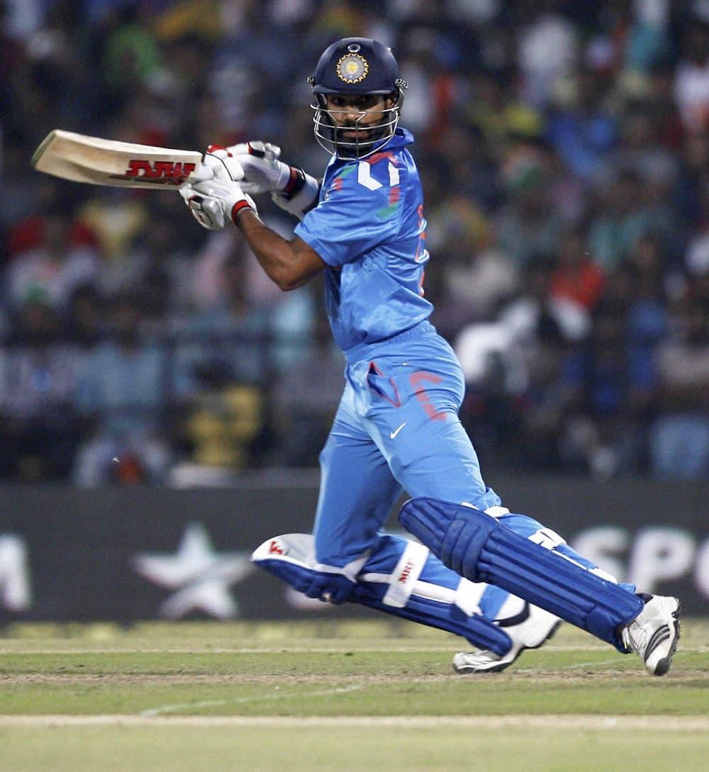 Shikhar Dhawan plays a shot during their 6th ODI cricket match against Australia in Nagpur.