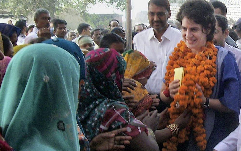 Priyanka Gandhi Vadra meeting people during a visit to Rae Bareli.