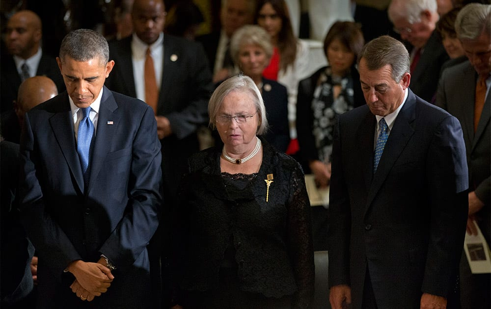 President Barack Obama, Heather Foley, and House Speaker John Boehner of Ohio, bow their heads at a memorial service for the former Speaker of the House Thomas S. Foley at Statuary Hall at the US Capitol in Washington.