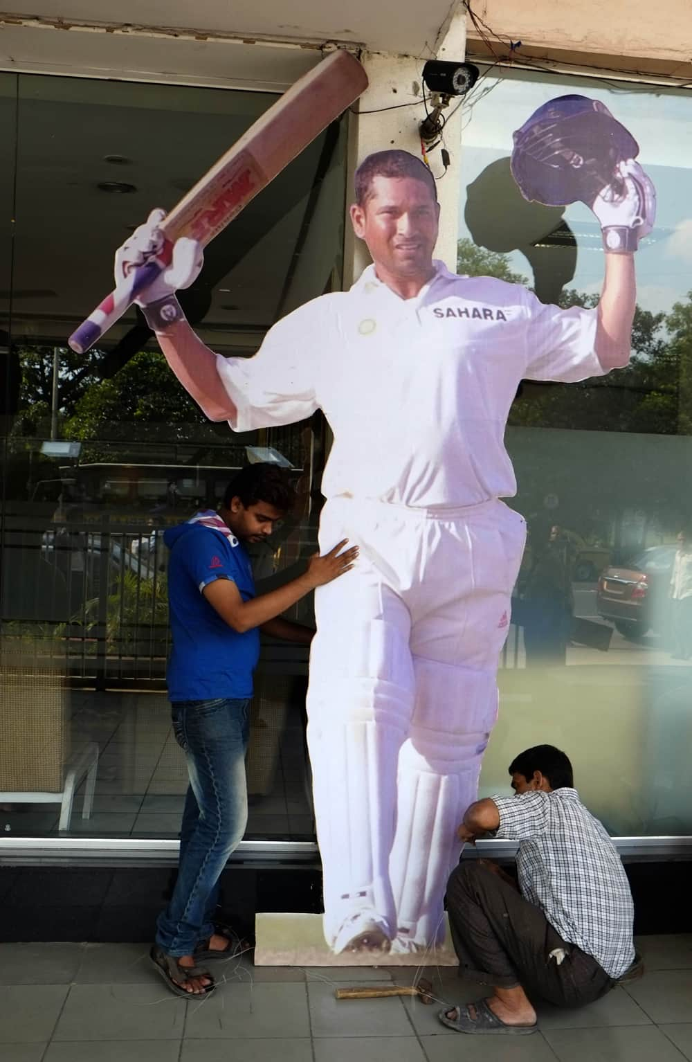 Workers erect a cut-out of Sachin Tendulkar at the entrance to Eden Gardens, the venue of the first test match between India and West Indies, in Kolkata.