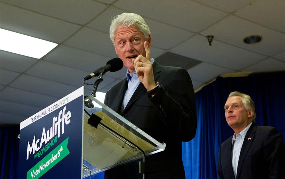 Former President Bill Clinton campaigns for Democratic gubernatorial candidate for Virginia, Terry McAuliffe, right, at a