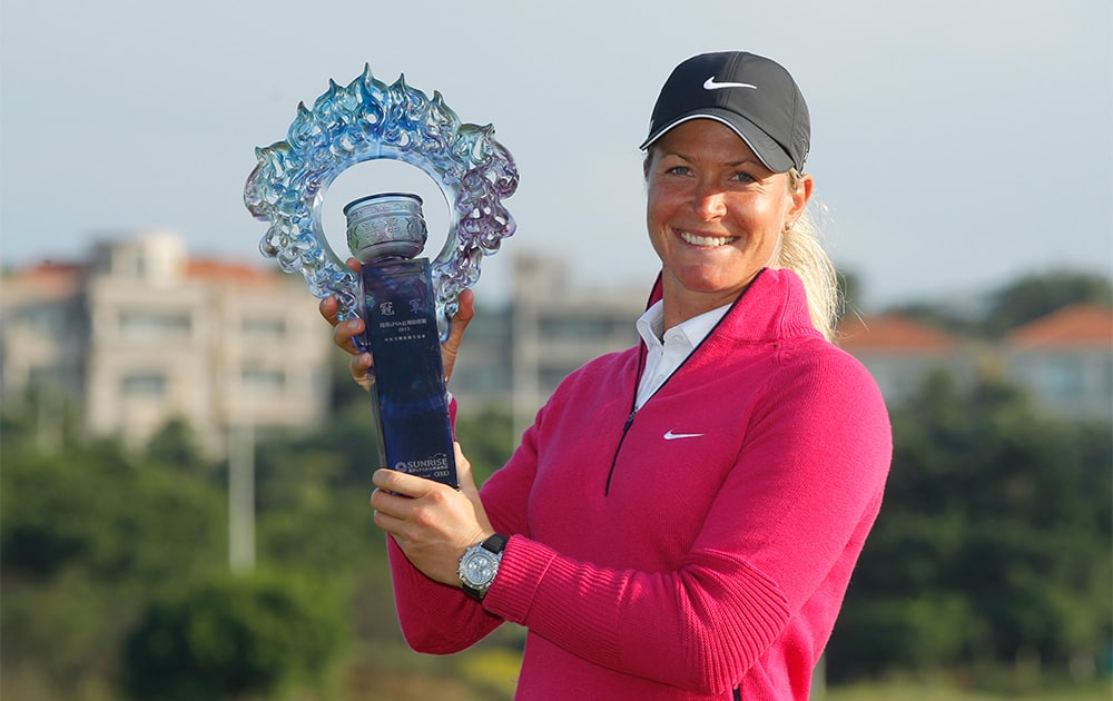 Suzann Pettersen of Norway, holds her trophy for media after winning the LPGA Taiwan Championship tournament at the Sunrise Golf & Country Club in Yangmei, northern Taiwan.