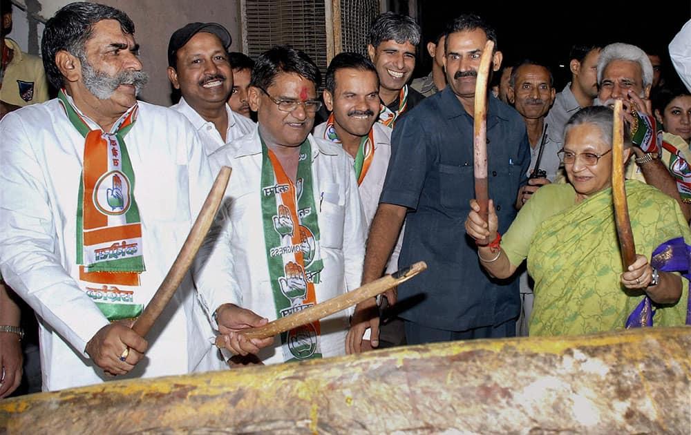 Delhi CM Sheila Dikshit launches Congress party`s Delhi Assembly poll campaign from Pilanji village in New Delhi.