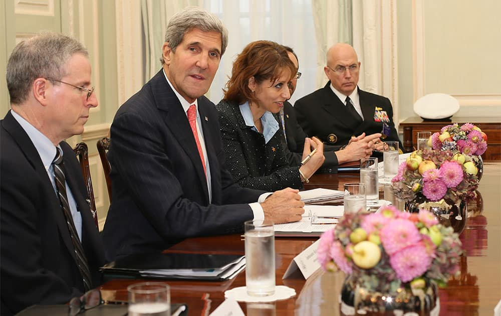 US Secretary of State John Kerry, second left, meets members of the Syrian opposition coalition, at the US Ambassador`s residence in London.