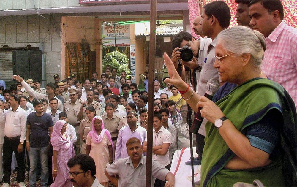 Delhi Chief Minister Sheila Dikshit addressing a gathering at Nangloi in New Delhi.