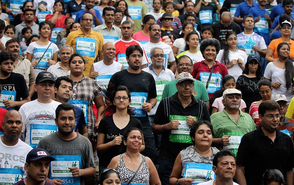 Indians participate in the second edition of Max Bupa walk for health initiative in Mumbai.