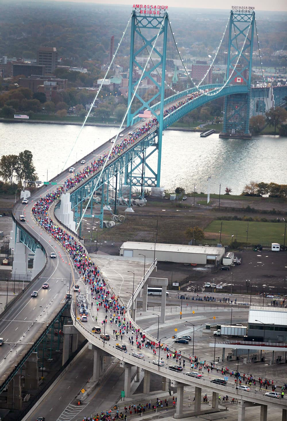 Runners cross the Ambassador Bridge during the 2013 Detroit Marathon.
