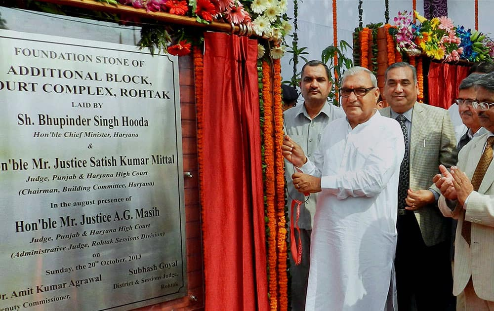 Haryana Chief Minister Bhupinder Singh Hooda and Justice Satish Kumar Mittal, Judge Punjab and Haryana High Court and Chairman of Building Committee laying the foundation stone of Additional Block Court Complex at district Rohtak.