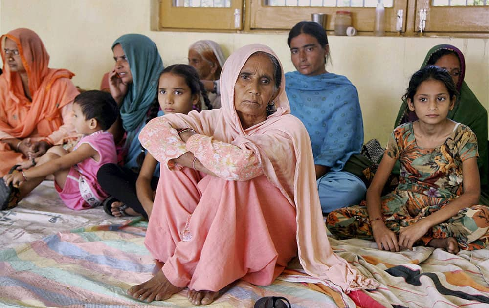 Vilagers of Suchetgarh border take shelter at a community hall over fear of becoming targets of shelling from Pakistan side at Kali Bari village in Samba 45km from Jammu.