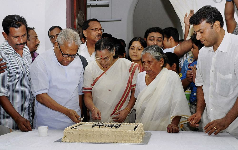 CPI(M) veteran and former Kerala CM V S Achuthanandan cuts cake on his 90th birth day with his wife Vasumathi and other family members in Thiruvananthapuram.