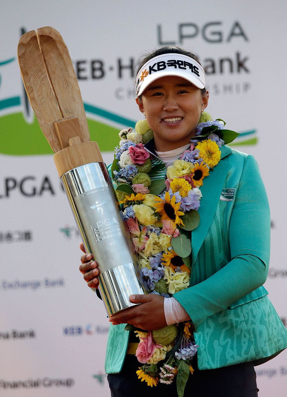 Amy Yang of South Korea poses with the trophy for the media after winning the KEB Hana Bank Championship golf tournament at Sky72 Golf Club in Incheon, west of Seoul, South Korea.