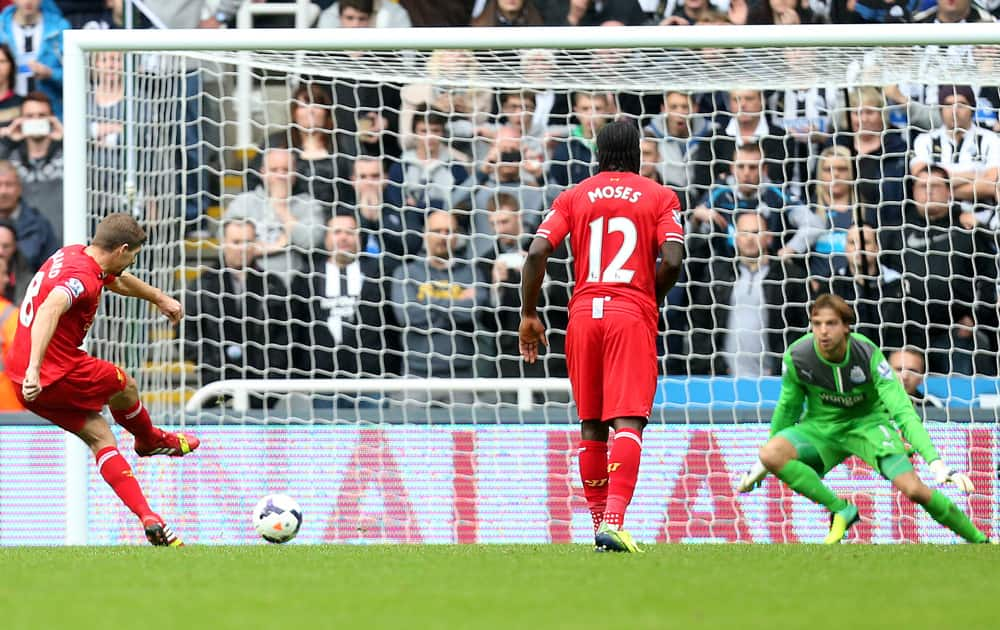Liverpool`s captain Steven Gerrard scores his goal from a penalty kick past Newcastle United`s goalkeeper Tim Krul during their English Premier League soccer match at St James` Park, Newcastle, England.