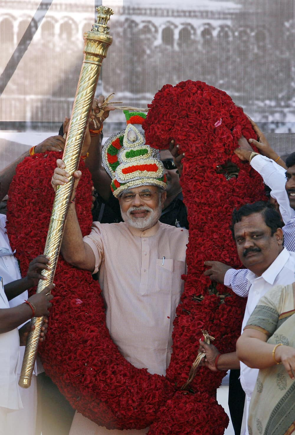Gujarat state Chief Minister and Bharatiya Janata Party (BJP) leader Narendra Modi receives scepter and a floral garland during his visit to Chennai.