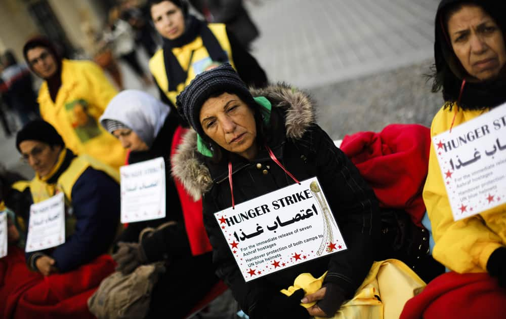 Supporters of the National Council of Resistance of Iran attend a hunger strike in protest against the situation in the Ashraf and Liberty Camps near Baghdad, in front of the Brandenburg Gate in Berlin, Germany.