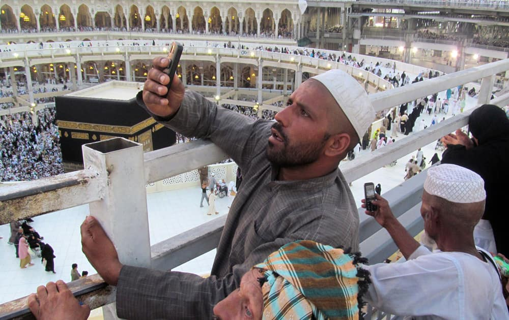 Muslim pilgrims take pictures of the Grand Mosque, in the Muslim holy city of Mecca, Saudi Arabia.
