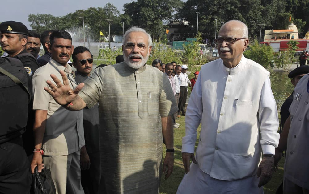 Gujarat state Chief Minister Narendra Modi walks with L.K. Advani during the inauguration of a riverfront park in Ahmadabad.