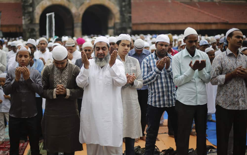 Muslim men offer prayers during Eid al-Adha, or the Feast of the Sacrifice, in Mumbai.