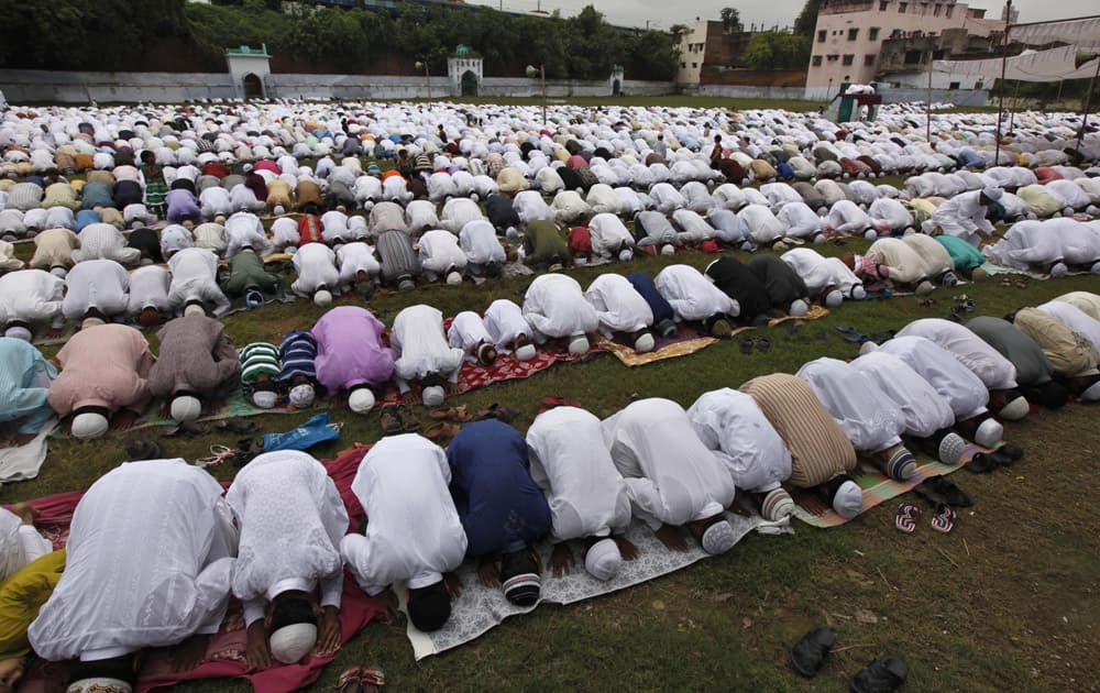 Muslims offer prayers during Eid al-Adha in Allahabad.