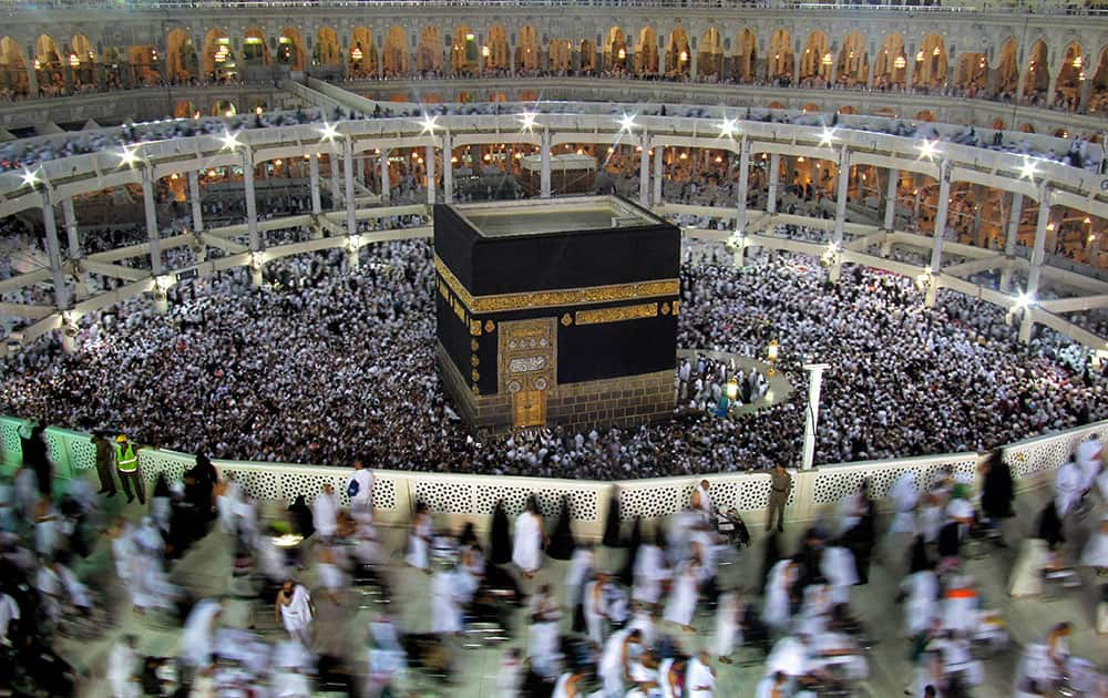 Muslim pilgrims circle the Kaaba as they pray inside the Grand Mosque during the hajj, or pilgrimage, in the Muslim holy city of Mecca, Saudi Arabia.