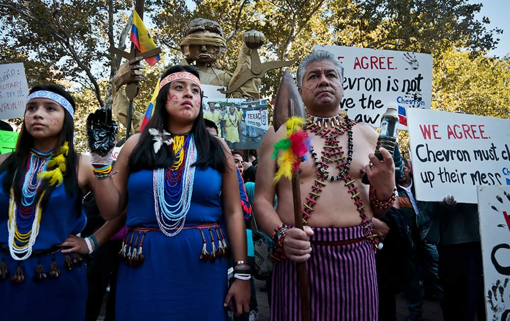Protestors rally outside a federal court in New York to protest oil giant Chevron`s