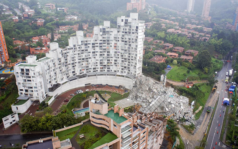 A tower lays in ruins at the Space development after it collapsed late Saturday in Medellin, Colombia.