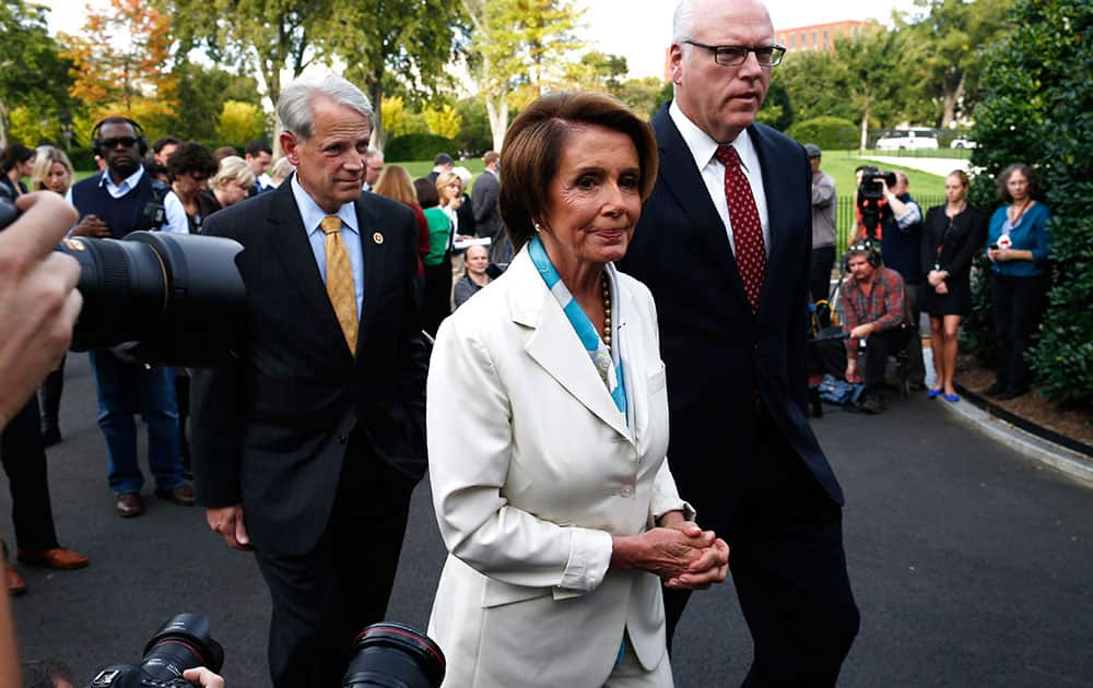 House Minority Leader Nancy Pelosi of Calif., center, walks away after answering questions from reporters with Rep. Steve Israel, D-N.Y., and Rep. Joseph Crowley, D-N.Y., right, after their meeting with President Barack Obama regarding the partial government shutdown and looming debt default outside the West Wing at the White House in Washington.