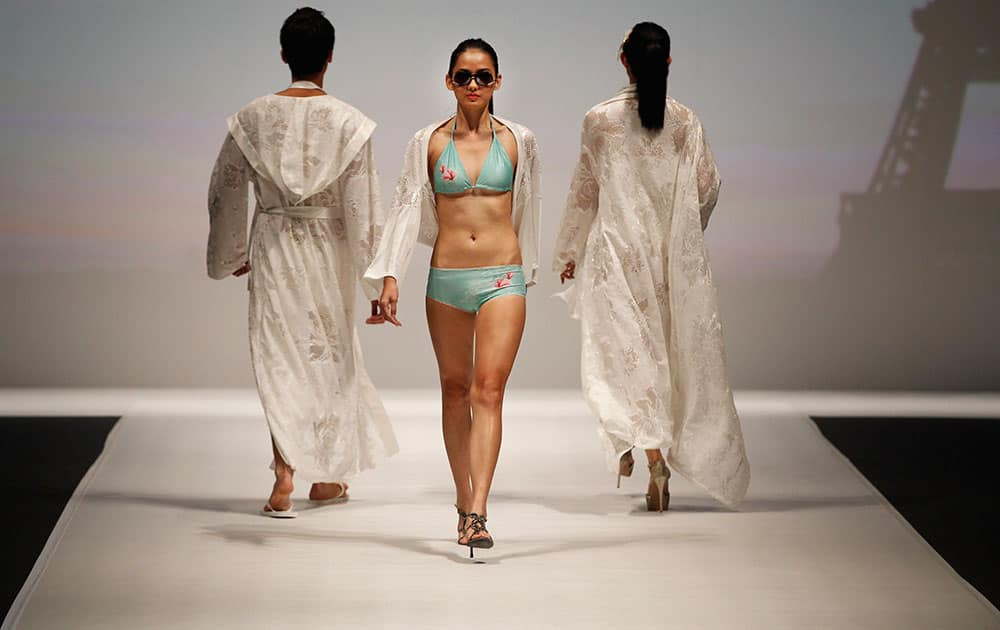 Models display creations by Hong Kong designer brand Mondovi Lingerie Couture during the Taipei IN Style fashion show in Taipei, Taiwan.