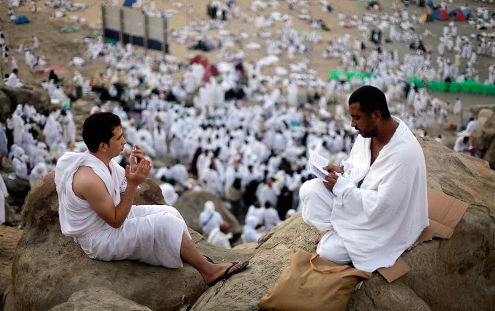 Muslim pilgrims pray on a rocky hill called the Mountain of Mercy, near the holy city of Mecca, Saudi Arabia.