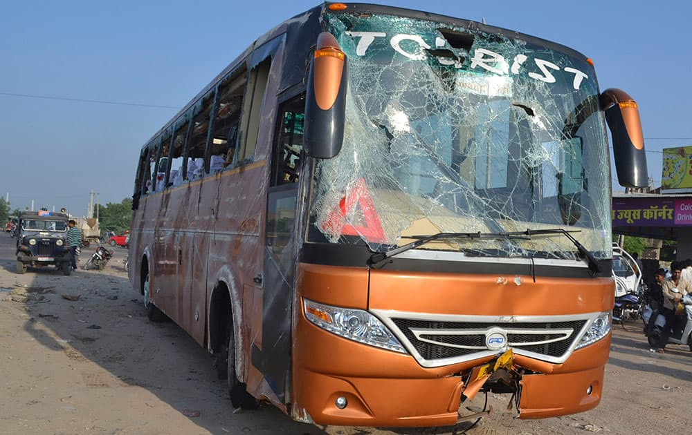 A tour bus that was hit by a truck stands damaged in Jodhpur, Rajasthan state, India. Four French tourists are in critical condition after the tour bus they were on was hit by a truck and overturned in a northwest Indian city.
