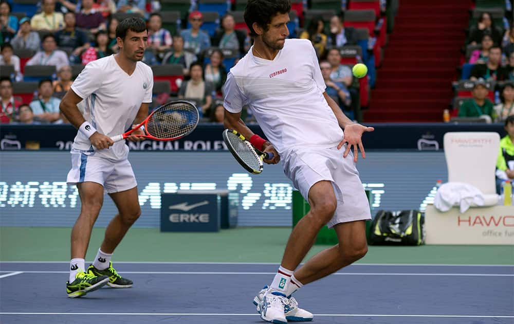 Brazil`s Marcelo Melo, right, and Croatia`s Ivan Dodig play against Spain`s David Marrero and compatriot Fernando Verdasco in the doubles final match of the Shanghai Masters tennis tournament at the Qizhong Forest Sports City Tennis Center in Shanghai, China.
