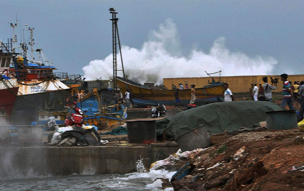 A high tide wave hits the coastal area of Vishakhapatnam in Andhra Pradesh state.