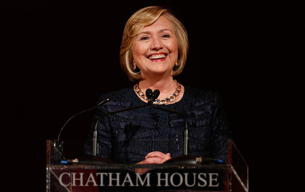 Former US Secretary of State Hillary Rodham Clinton, reacts, during the Chatham House Prize award ceremony in central London.