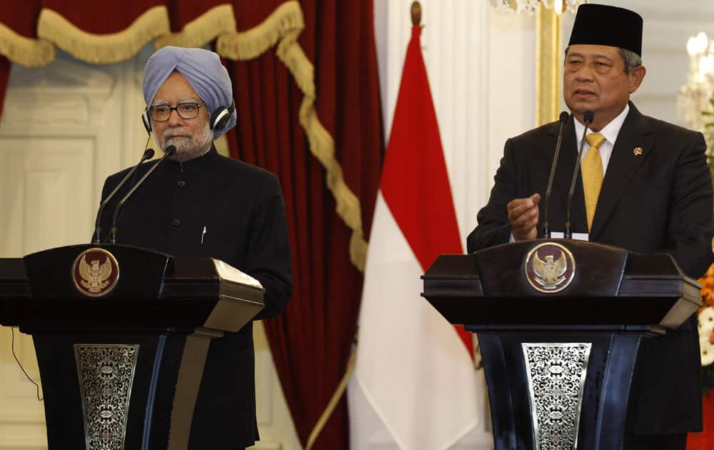 Indian Prime Minister Manmohan Singh listens to Indonesian President Susilo Bambang Yudhoyono speaking during a joint press conference at Merdeka Palace in Jakarta, Indonesia.