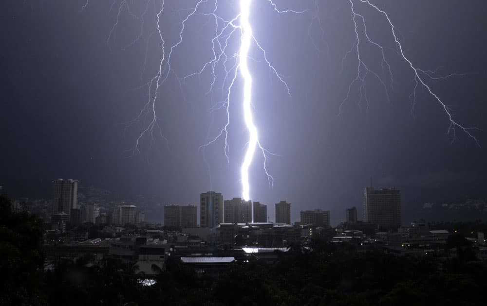 A bolt of lightning strikes down over the Pacific resort city of Acapulco, Mexico, during a thunderstorm.