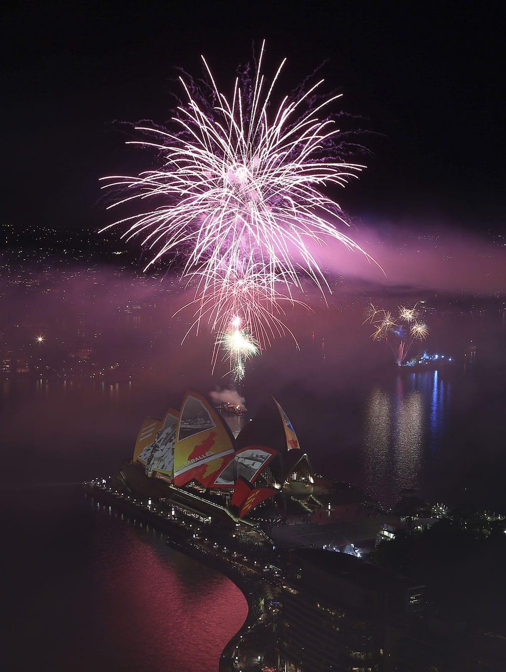 Fireworks explode over Sydney Harbour in Australia, during the International Fleet review celebrations.